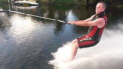 Patient, Matt Ellis water skiiing 12 weeks after his first total knee replacement.